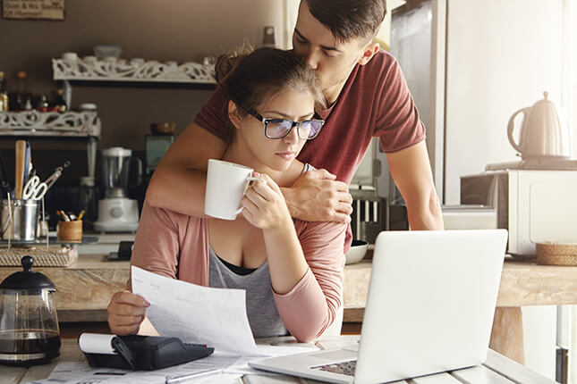 Young couple going through personal injury bills and expenses