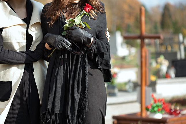 A woman with a rose at burial site