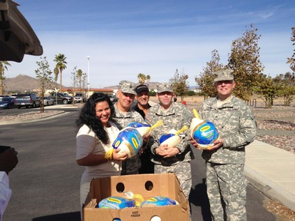 John Bisnar photographed with military members receiving turkeys for their families.